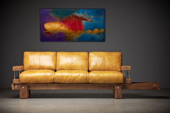 Obraz w salonie nad sofą